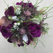 A collection of wedding bouquets featuring  artificial purple flowers & thistles