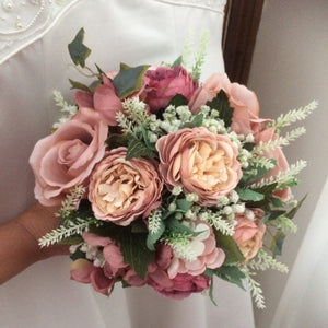 A bridal bouquet of roses, hydrangea and ranunculus