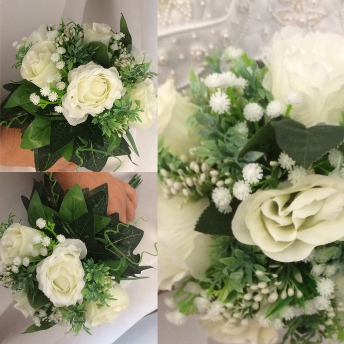 A collection of wedding bouquet  ivory roses, gyp and diamanté strands