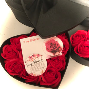 red soap roses in black heart box