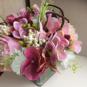 A flower arrangement of pink peonies & hydrangea