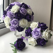 A bouquet collection of artificial purple lilac & ivory foam roses with diamante