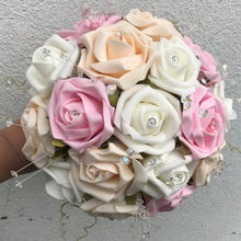 a wedding of pink ivory and champagne foam roses