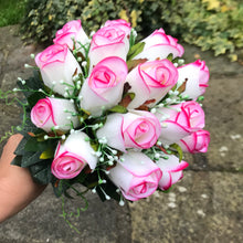 A bridal bouquet of pink edged roses