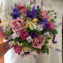 A collection of wedding bouquets featuring  artificial purple and pink flowers