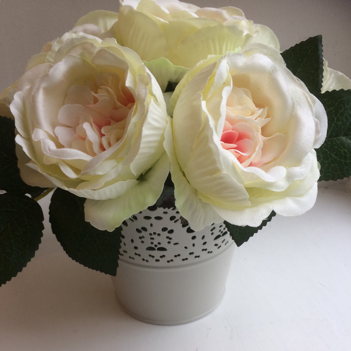 cream and pink silk roses arranged in pot