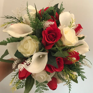 A wedding bouquet of red white and ivory roses tulips and calla