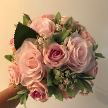 An artificial wedding bouquet featuring pink flowers