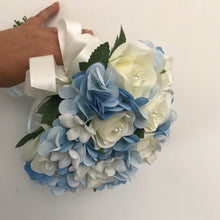 A wedding bouquet collection of blue and ivory roses & hydrangea
