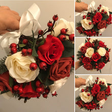 red and ivory roses cones and berries feature in this wedding bouquet