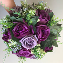 a wedding bouquet of purple and lilac foam and silk roses