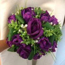 A bridal bouquet of tulips and roses( also available in ivory)