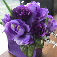 A bouquet arrangement in purple box