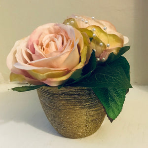 An arrangement of blush silk roses