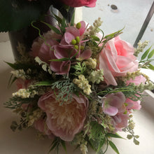 a bouquet of pink roses and peonies