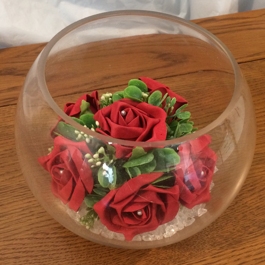 An arrangement of foam roses in glass fish bowl (choice of colours)