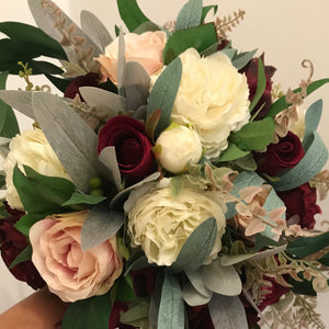 A bridal bouquet of artificial roses and hydrangea