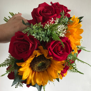 a wedding bouquet featuring artificial red roses, gyp & sunflowers