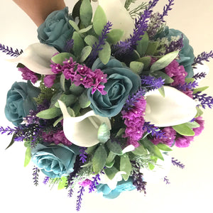A brides bouquet of white calla, teal roses and foliage