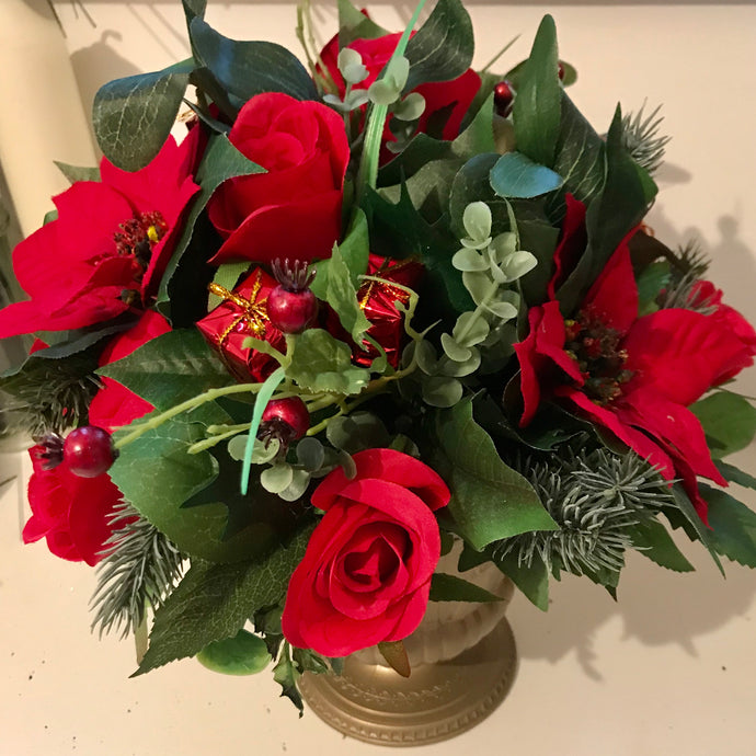 A Christmas artificial flower arrangement