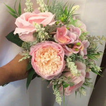 A wedding bouquet of artificial silk pink roses peony