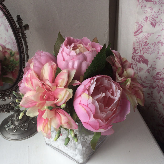 A flower arrangement of dahlia and peonies