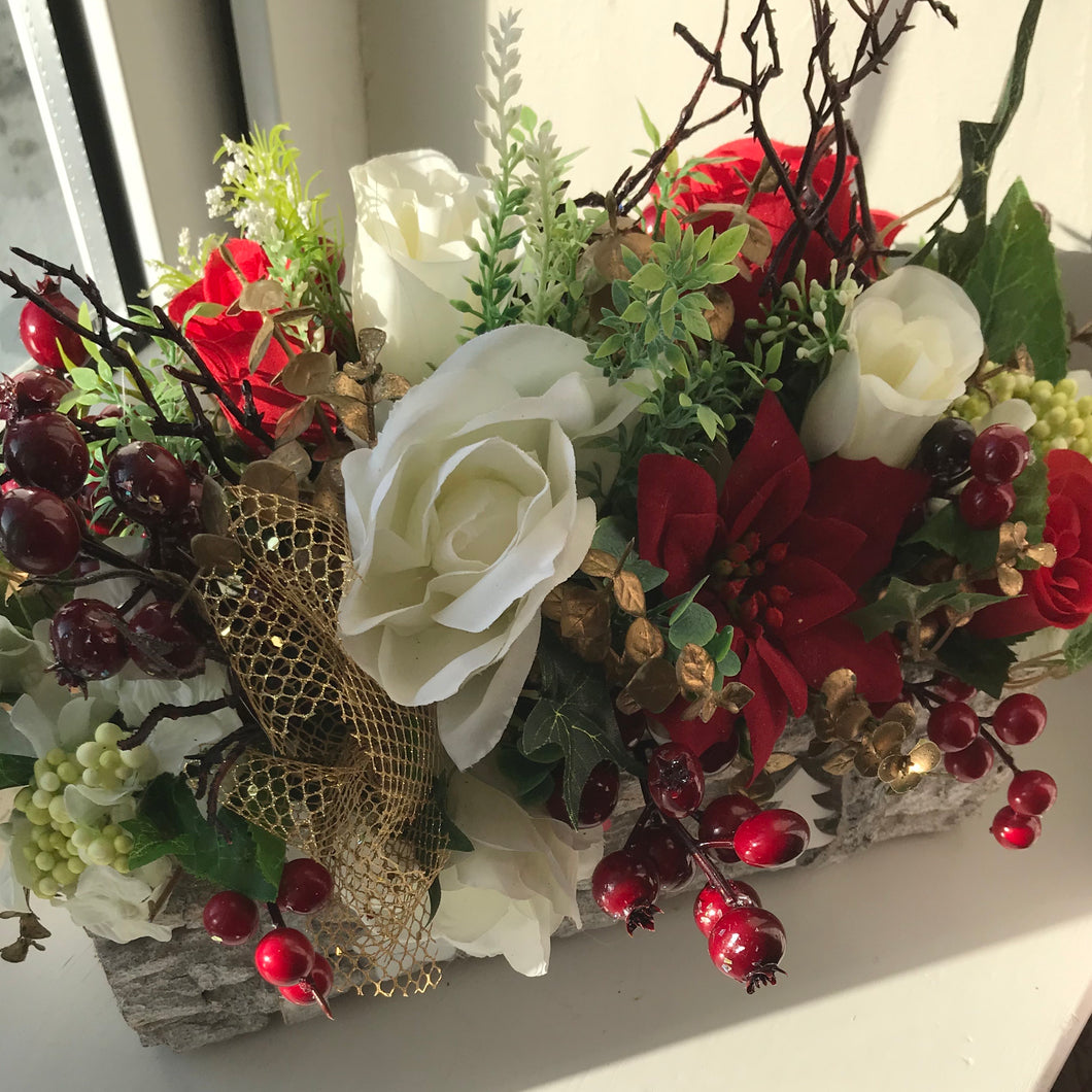 christmas flower arrangement of artificial flowers