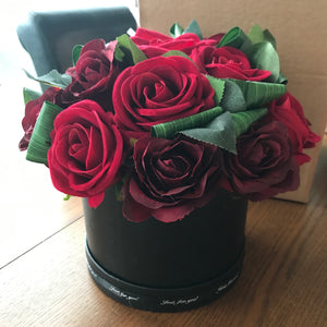 A Large flower design featuring Faux Silk Red Roses in Hat Box