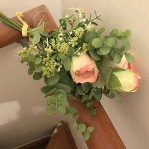 mixed bunch of artifial roses and foliage