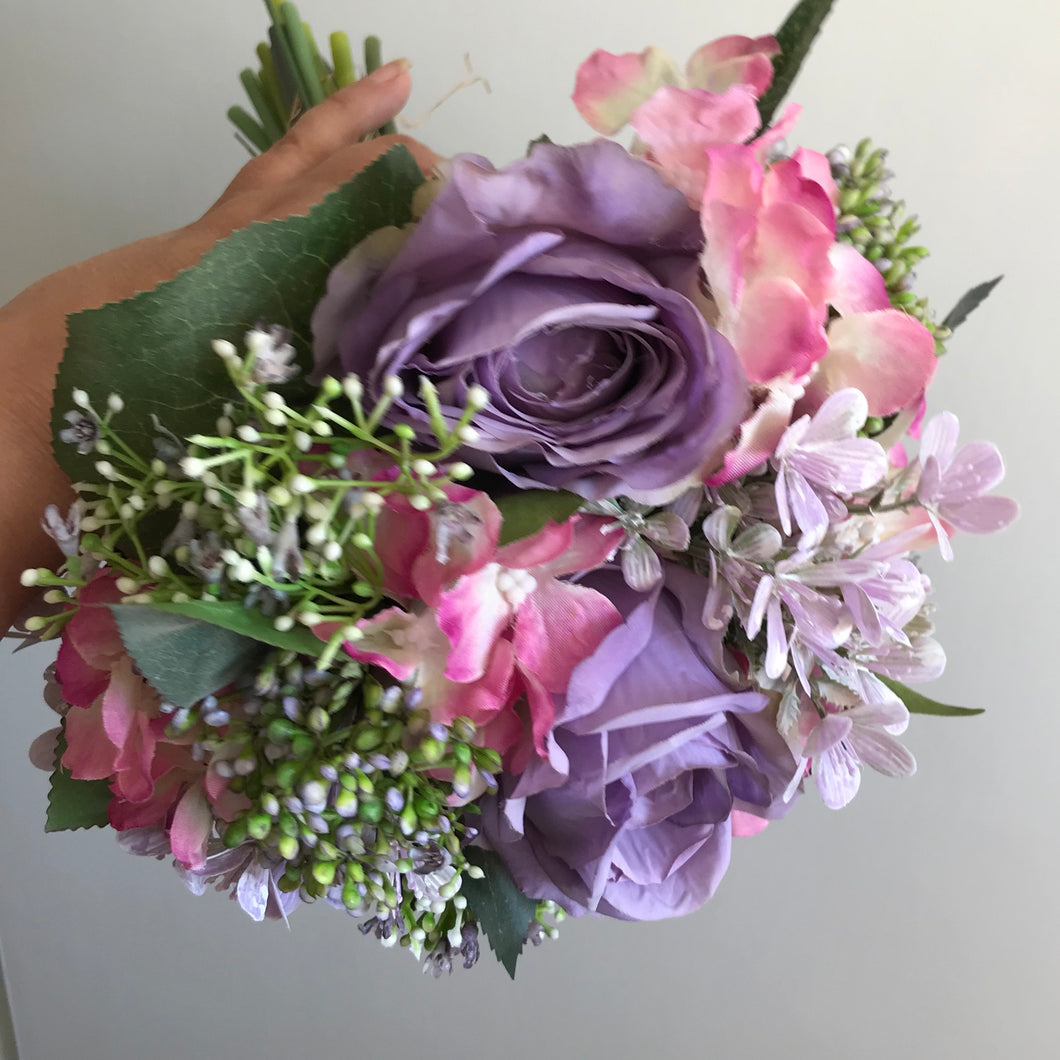 A wedding bouquet of lilac silk flowers