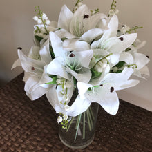 artificial white lilies in vase