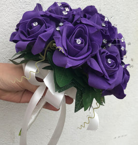 - a wedding bouquet of artificial purple foam roses with diamante centres