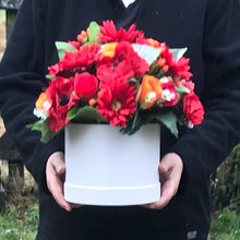 Ex large flower arrangement in hat box featuring red and orange flowers