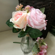 an arrangement of artificial pink flowers
