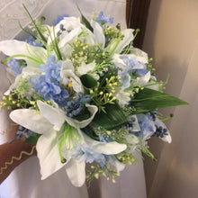 A brides bouquet of artificial lily flowers
