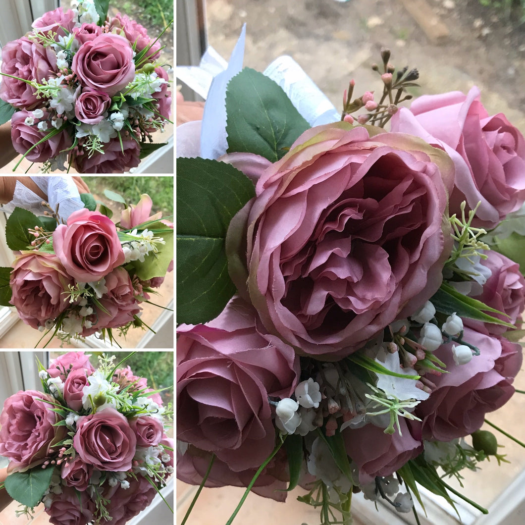 A wedding bouquet collection of artificial dusky pink roses