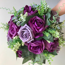 an artificial wedding bouquet of purple flowers