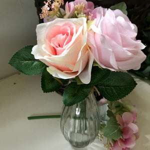 A posy of roses and hydrangea in glass vase