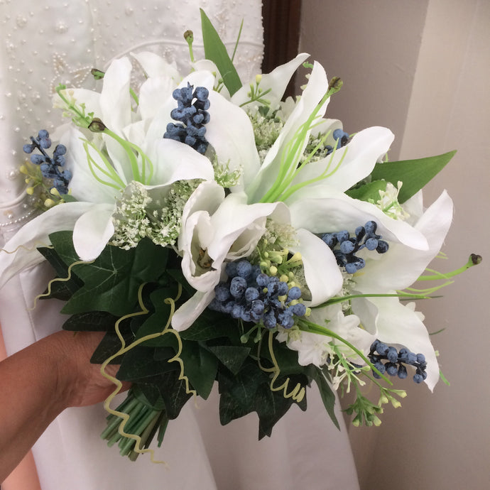 a wedding bouquet of faux lilies