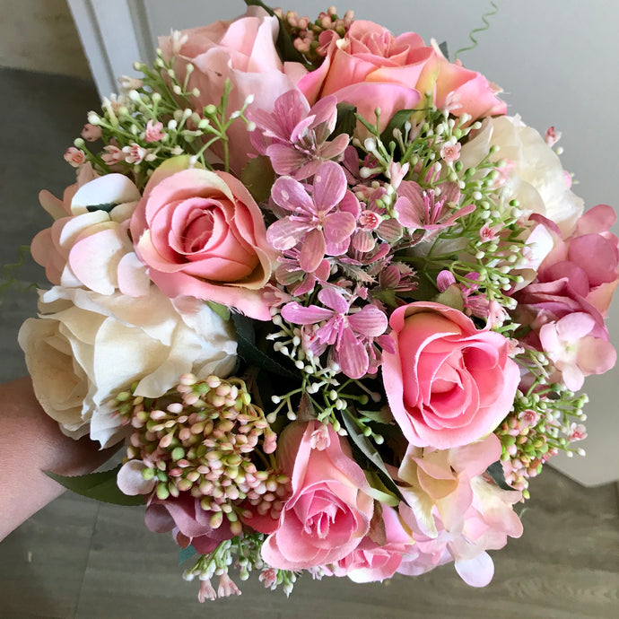 artificial wedding bouquet of pink and lilac flowers