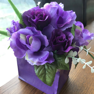 purple roses in bouquet box