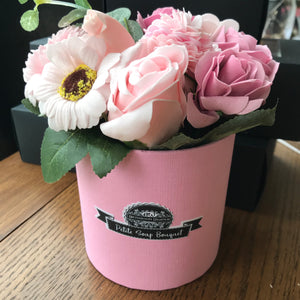 pink soap flowers in pot