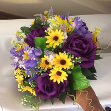 - A bouquet collection of purple and yellow daisies & freesia