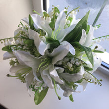 a bouquet of artificial white lilies