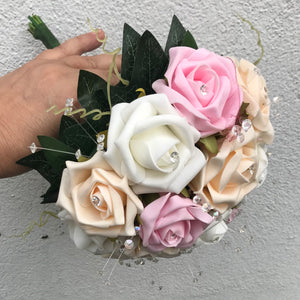 A wedding bouquet collection of artificial ivory champagne & pink foam Roses