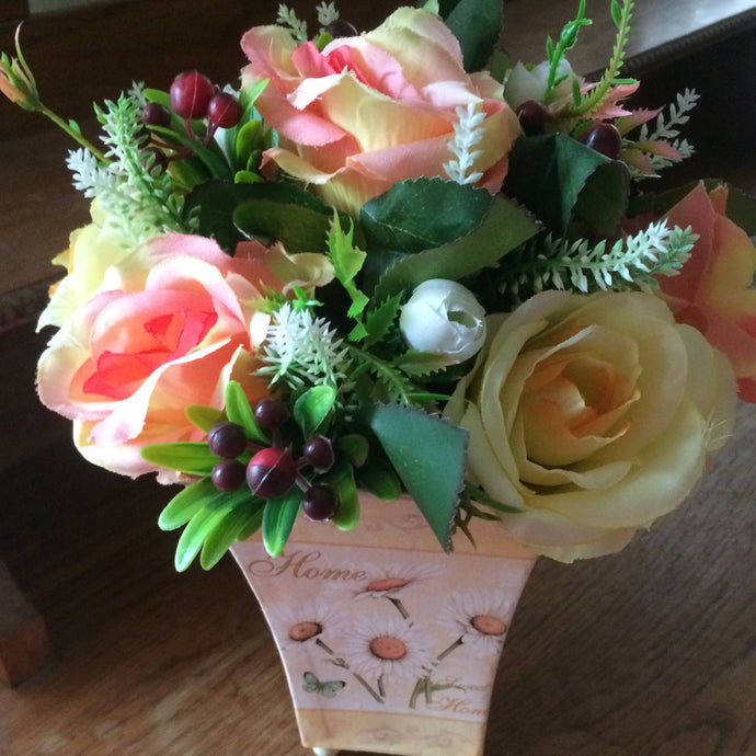 yellow and peach flowee arrangement