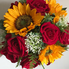 - a wedding bouquet featuring artificial red roses, gyp & sunflowers