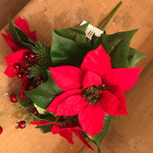 A bunch of Artificial Christmas foliage and poinsettia flowers