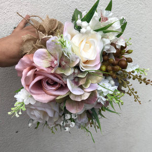 roses and hydrangea feature in this wedding bouquet