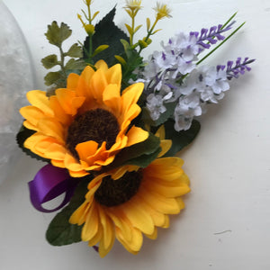 A corsage of sunflowers and lavender